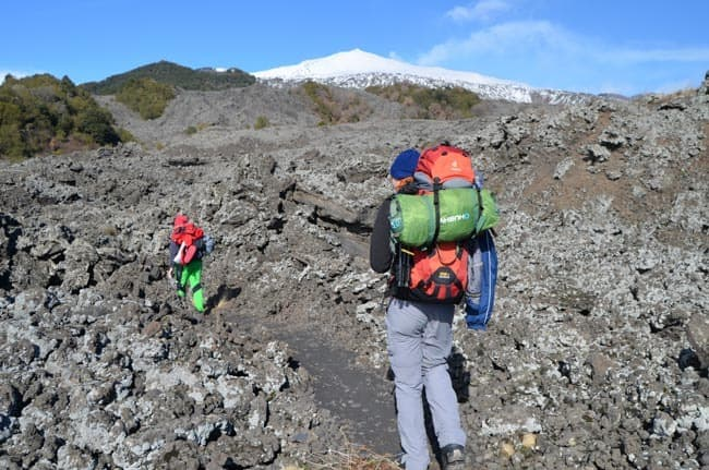 All you need to know for climbing Mount Etna Volcano on Sicily in 2019. How to get there? How long does it take? What to pack for the hiking trek?