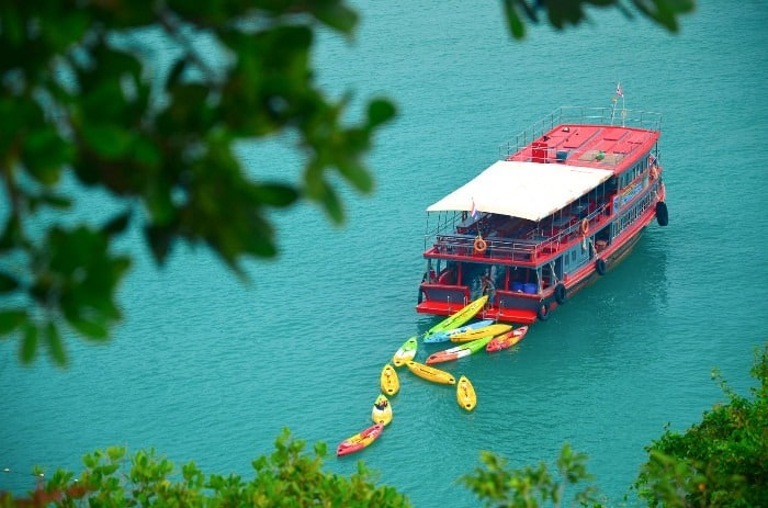 Slower Ferry Boat is waiting in the bay for its passengers. Ang Thong National Marine Park kayak tour.