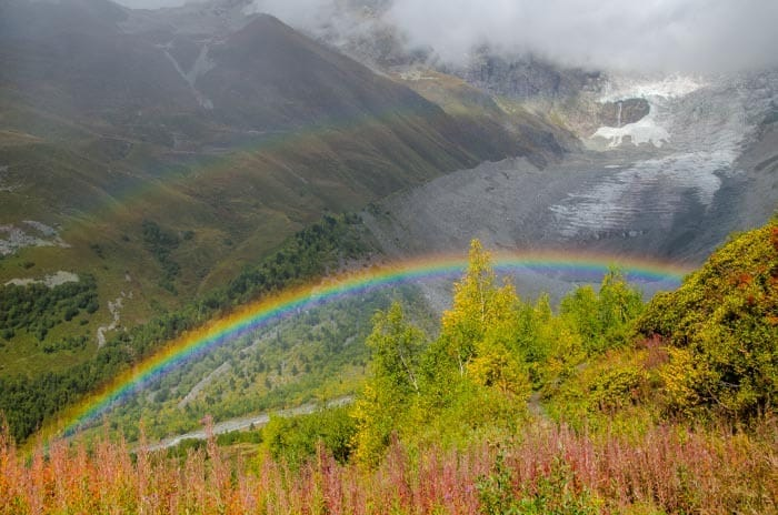 Glacier with a rainbow in the foreground on the trek to Ushguli, Svaneti, northern Georgia.