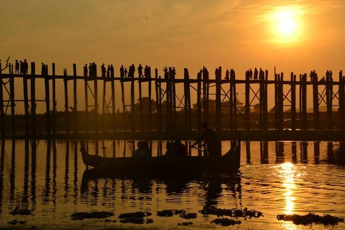 Visit U Bein Bridge during the sunset.