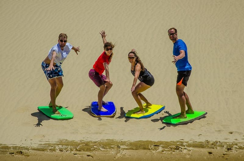 Your guide to Te Paki Sand Dunes - the best New Zealand's sand surfing. Get the cheapest board! Slide the best dune! Giant sand dunes surfing in Northland.