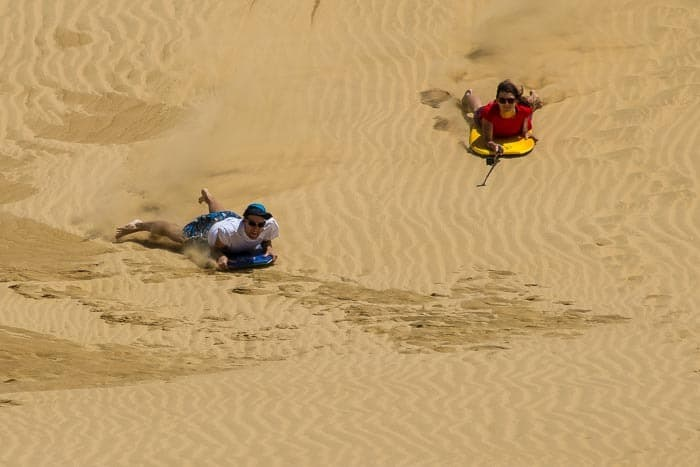 Group rides are more fun! Sand Dune Surfing at Te Paki.