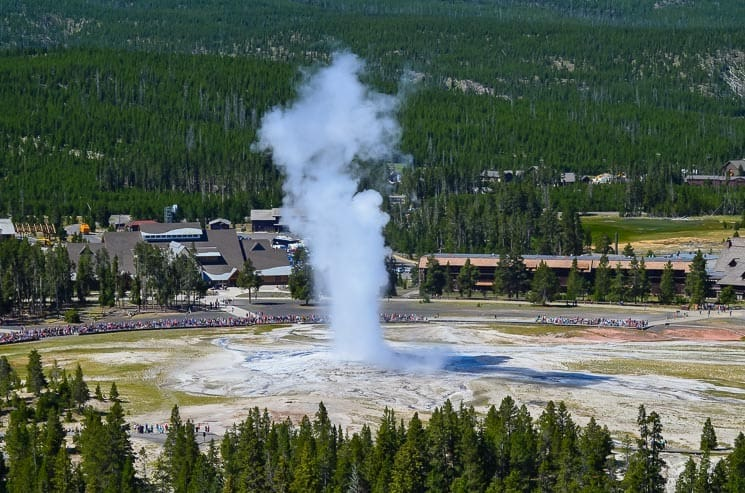 Old Faithful Geyser from the Observation Point (1-hour loop track). Best things to see in Yellowstone National Park.