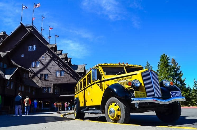 Historical vehicle in front of the Old Faithful Inn.