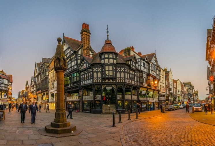 Tudor houses alongside the Bridge street in the central Chester - Day Trips from Liverpool